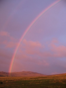 Evening rainbow over the countryside near Oatlands, Tasmania, Australia